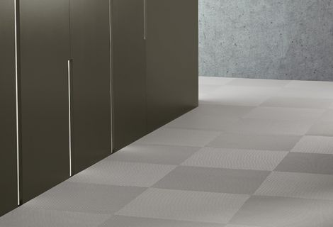 Interwoven vinyl tiles